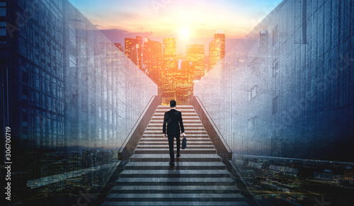 Fototapeta Ambitious business man climbing stairs to meet incoming challenge and business opportunity. The high stair represents the concept of career path success, future planning and business competitions. obraz