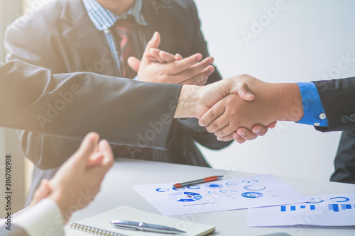 Photo soft Focus,A group of businessmen are handshake together to show the symbol of congratulations that the deal has been completed