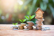 Leinwanddruck Bild - house model on money coins saving for concept investment mortgage fund finance and home loan refinance