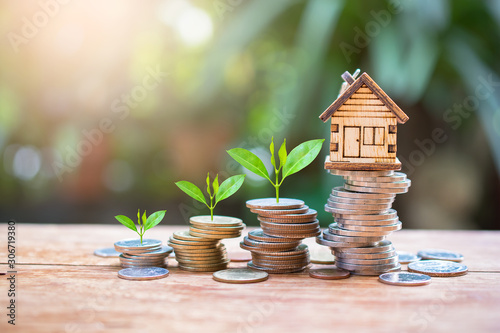 Obraz house model on money coins saving for concept investment mortgage fund finance and home loan refinance - fototapety do salonu