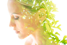 Double Exposure Close Up Profile Portrait Of A Young Pretty Woman Interwoven With Bright Leaves Of A Vibrant Tropical Tree