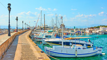 Pier With Moored Fishing Boats In The Port Of Aegina Town