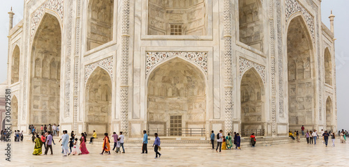 Panorama of people walking around the Taj Mahal monument in Agra, India Canvas Print