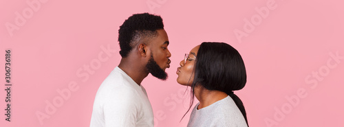 Fototapeta Romantic photo of black man and woman about to kiss