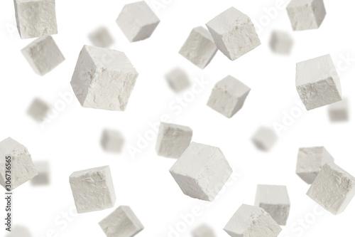 Fototapeta Falling Feta, Greek cheese cubes, isolated on white background, selective focus obraz