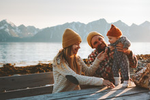 Happy Family Outdoor Mother And Father With Baby Traveling Together Vacation Parents Playing With Child Healthy Lifestyle Mountains View In Norway