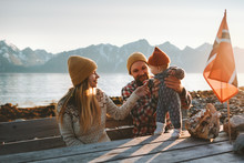 Family Mother And Father With Baby Traveling Together Vacation Outdoor Parents With Child Healthy Lifestyle Mountains View In Norway
