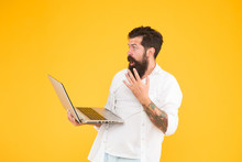 Dont Know What To Do. Programming Concept. Brutal Man Surfing Internet. Hipster Use Notebook. Bearded Man Laptop Yellow Background. Shopping Online. Successful Developer. Education In Digital World