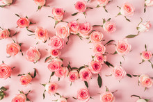 Flat Lay Frame Border With Blank Copy Space Mockup Made Of Pink Rose Flower Buds On Pink Background. Top View Floral Concept.