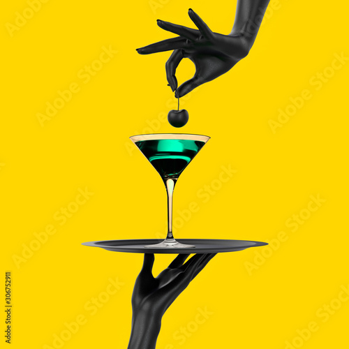 Fotografía Black Hand holding tray with cocktail martini glass isolated on yellow