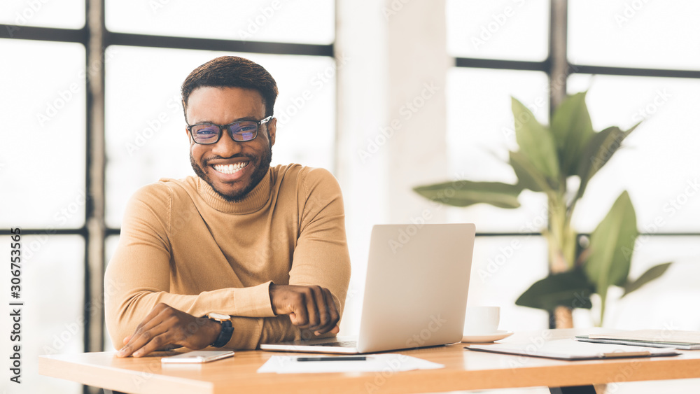 Fototapeta Portrait of handsome black man looking at camera