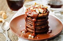 Chocolate Pancake With Bananas, Nuts, Chocolate Sauce And Glass Of Coffee