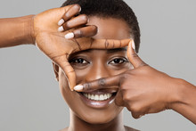 Beautiful African Woman Holding Frame From Fingers Near Her Eyes