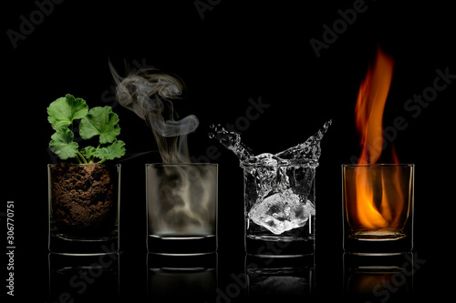 Valokuvatapetti Four elements concept in glasses. earth, air, water, fire.