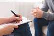 Leinwandbild Motiv Therapist noting patient speech during personal session