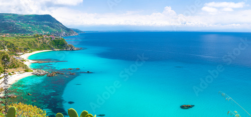 Foto auf AluDibond Turkis Aerial amazing tropical panoramic view of turquoise gulf bay, sandy beach, green mountains and plants, blue sky white clouds background, cliffs platform Cape Capo Vaticano, Calabria, Southern Italy