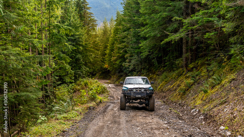 Fotografie, Tablou  British Columbia, Canada. Off-road monster truck in the forest.
