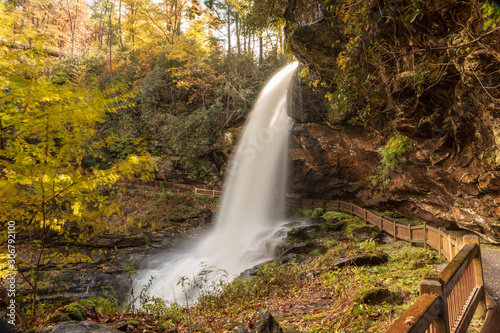 sunny waterfall in the fall