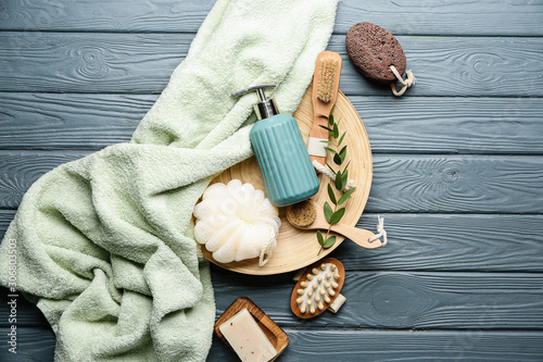 Photo Set of bath accessories on wooden background