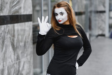 The Girl With Makeup Of The Mime. Improvisation. Mime Shows Different Emotions