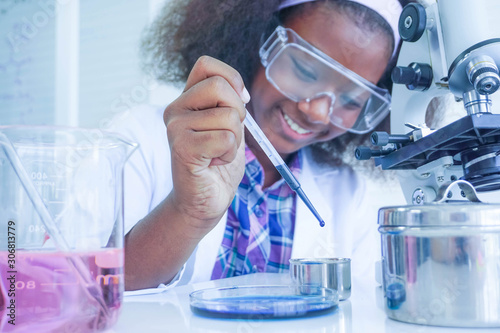 Fotografía  African kid girl scientist testing liquid chemical in laboratory,reserch and development concept