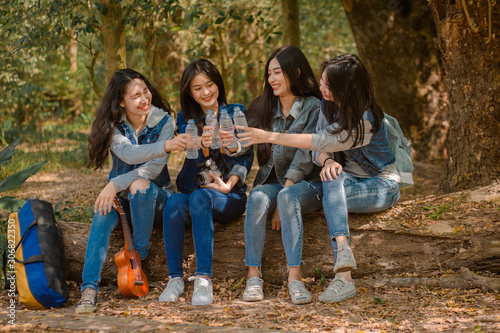 Group of Cheerful diverse young girls sitting together relax and drink water ,af Canvas Print