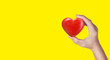 canvas print picture - Hands holding a red heart .health donation concepts