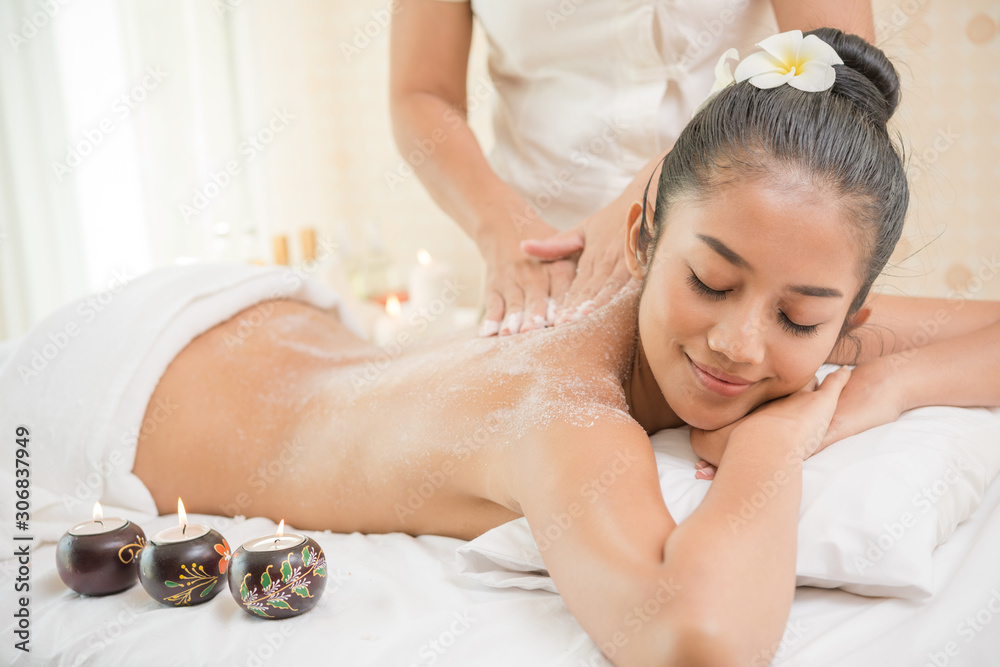 Fototapeta Beautiful woman having exfoliation treatment in spa
