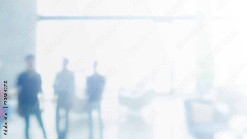 Fototapeta Abstract blurred interior modern office space with business people working banner background with copy space.