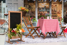 Table And Chairs In Front Of A Cafe In Italy Or France. Provence Style