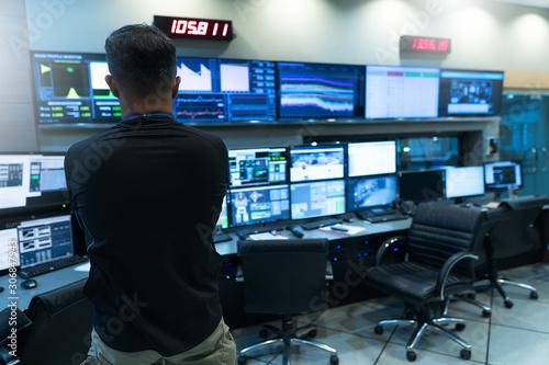 Fototapeta Engineer looking to work in the electrical control room obraz