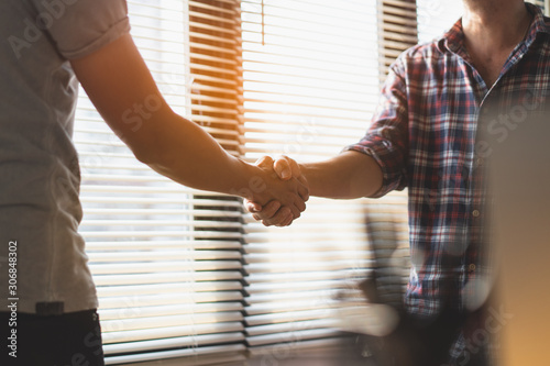 Successful deal, male architect shaking hands with client. Wallpaper Mural