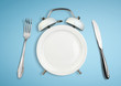 Leinwandbild Motiv Concept of intermittent fasting, diet and weight loss. Plate as Alarm clock