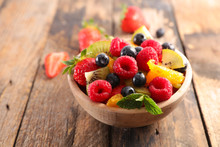 Bowl Of Fruit Salad With Berry, Orange, Kiwi And Mint