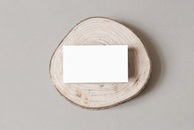 Blank White Business Card Mockup On Wooden Plate, Chop Board. Grey Table Backgound. Modern Minimalist Template. Branding Identity. Natural Winter Design. Flat Lay, Top View.