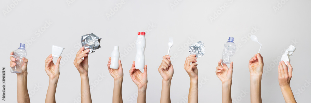 Hands hold trash on a light background. The concept of separate trash, stop plastic, recycling