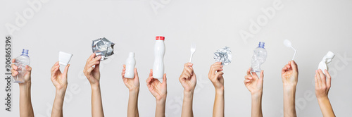 Fototapety, obrazy: Hands hold trash on a light background. The concept of separate trash, stop plastic, recycling