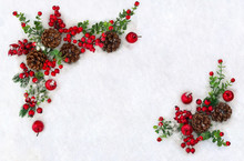 Christmas Decoration. Frame Of Cones Pine, Twigs Christmas Tree, Red Berries And Apples On Snow With Space For Text. Top View, Flat Lay