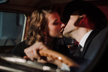 Selective Focus Of Couple Kissing In Retro Car