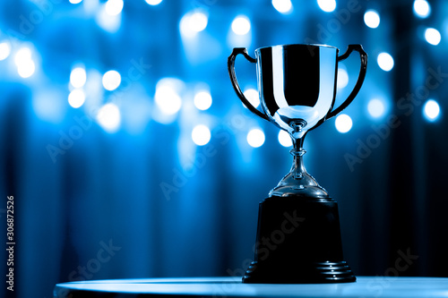Fotografiet Silver Trophy competition in the dark on the abstract blurred light background w
