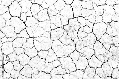 Fotografía  Texture soil dry crack background pattern of drought lack of water of nature white black old broken
