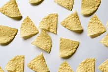 Overhead Shot Of Nachos On A White Surface - Great For Background