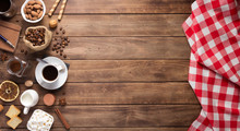 Coffee Beans With Cup At Wooden Table Background