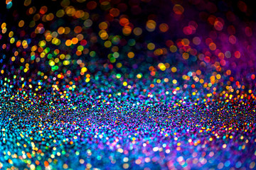 Shiny multicolor glitter raster background. Abstract shimmering pink, blue, yellow circles decorative backdrop. Bokeh lights effect illustration. Overlapping glowing and twinkling spots.
