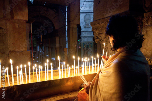 lighting candle the church of the holy sepulchre Canvas Print