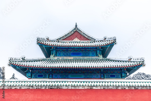 Red wall and snow in Temple of Heaven, Beijing, China Wallpaper Mural
