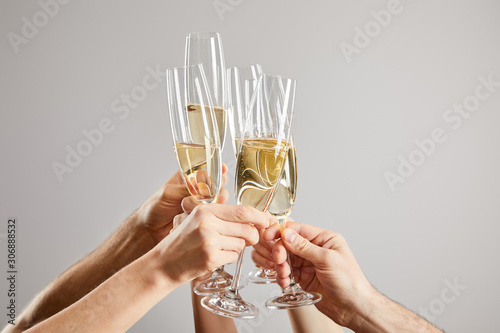 Obraz na plátně cropped view of men and women toasting champagne glasses with fresh sparkling wi
