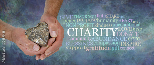 Heart Felt Charity Word Cloud - male hands holding a rustic wooden heart beside Canvas-taulu