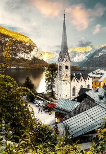 Wall mural - Wonderful Colorful Sunset at Hallstatt. view of famous Hallstatt mountain village, with lake Hallstatter See in the Austrian Alps, region of Salzkammergut, Austria. instagram filter. retro style