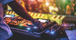 canvas print picture - Dj mixing outdoor at new year party festival with crowd of people in background - Nightlife view of disco club outside - Soft focus on bracelet, hand - Fun ,youth,entertainment and fest concept